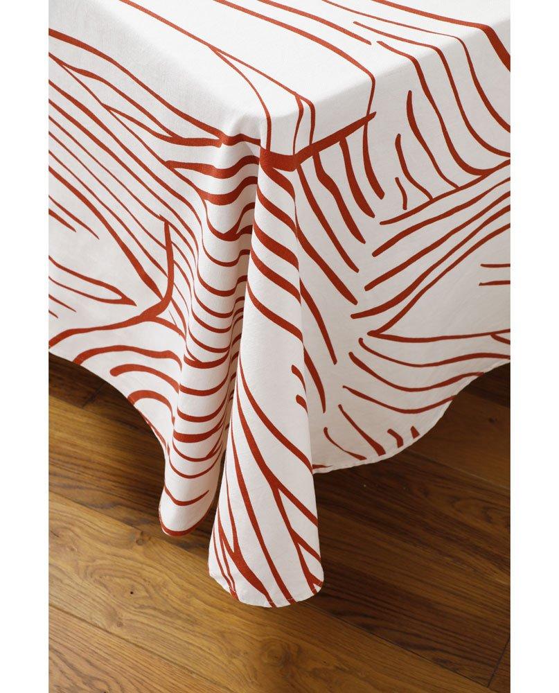 """Tombé de nappe """"Canopée"""" sur un coin de table. Imprimée sur lin coton."""